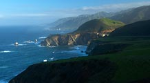 Dawn light breaks across the dramatic Big Sur section of the Central California coastline.