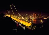 The Bay Bridge and San Francisco lit up during the holiday season.