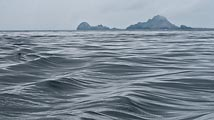 On this gloomy, overcast day the ocean emulates the shapes of the Farallon Islands off the coast of San Francisco.