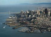 An aerial view of downtown San Francisco, the waterfront and the Oakland Bay Bridge.