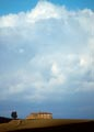 Storm clouds over a farm house in Italy's Tuscany region.
