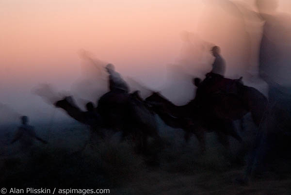 A slow shutter speed at twilight created this image of camel riders in the Jamba area of Rajasthan.