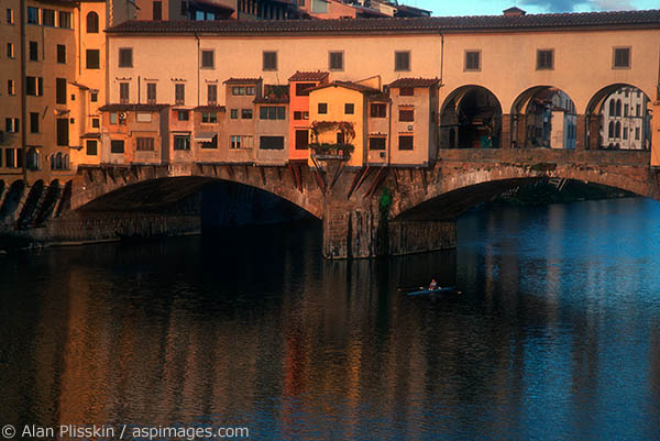 The famous Ponte Vecchio is a bustling marketplace during the day, but first thing in the morning the sculler was all that was moving.