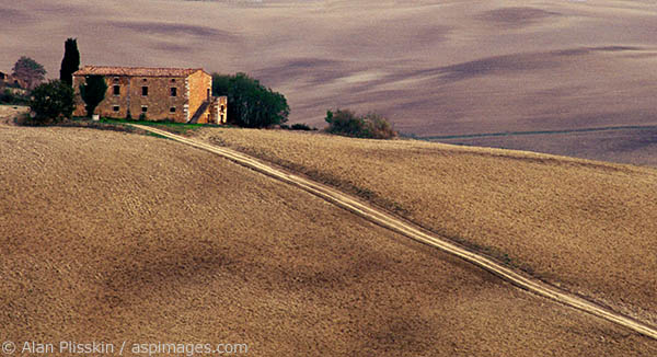 This old Tuscan farm sits on a ridge surrounded by plowed fields