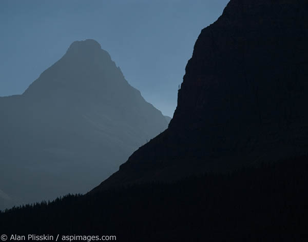 Mountains in Glacier National Park are silhouetted in the morning sun