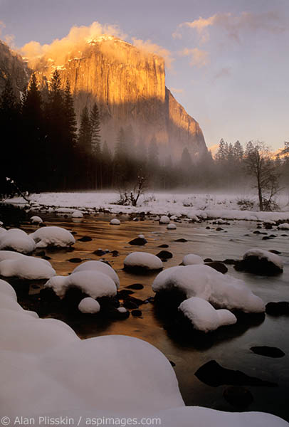 The sun broke through at the end of a cold winter day to light up the face of El Capitan in Yosemite National Park.
