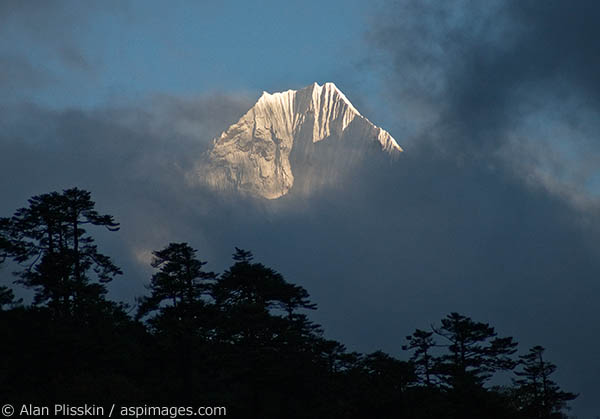 This peak near Namche Bazaar made a very brief appearance before falling behind the clouds.
