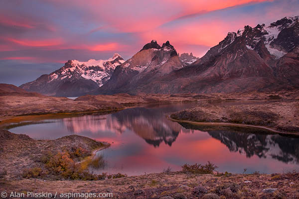 On our last sunrise in Torres del Paine, Chile we were fortunate enough to have some beautiful light.  The clouds changed from grey to pink to orange to yellow over this small lake.
