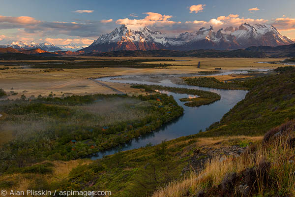 As the sun was rising the fog in the valley of the Rio Serrano was constantly changing.  The morning was peaceful and serene and the mountains of Cerro Paine Grande absorb the beautiful morning light.
