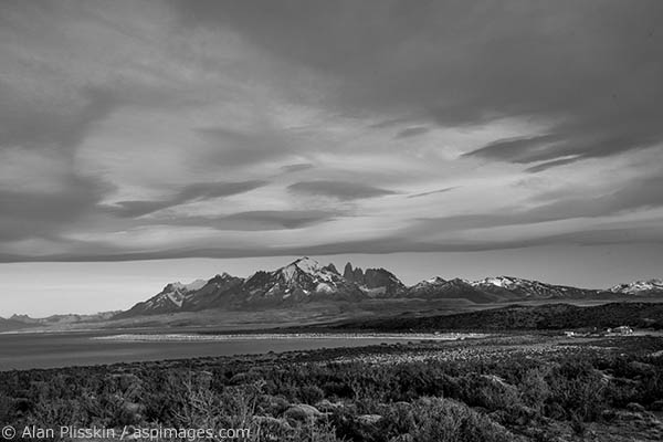 As we driving away from Torres del Paine National Park in Chile the lenticular clouds hovered over the mountains creating his dramatic scene.